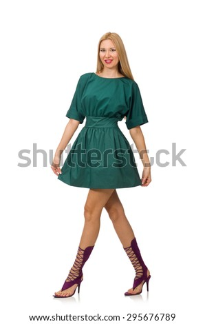 Young woman in green dress isolated on white - stock photo