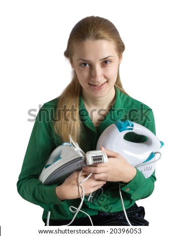 young woman in green with household appliances - stock photo
