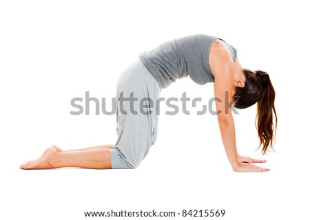young woman in grey clothes doing exercise. isolated on white background - stock photo