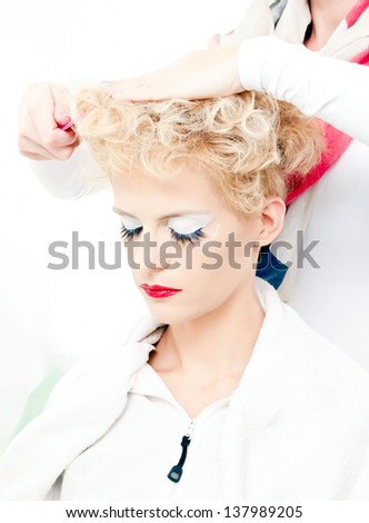 Young woman in hair salon - stock photo