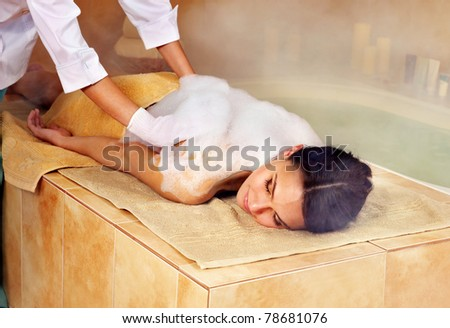 Young woman in hammam or turkish bath. - stock photo