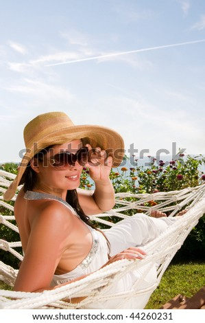 Young woman in hammock - stock photo