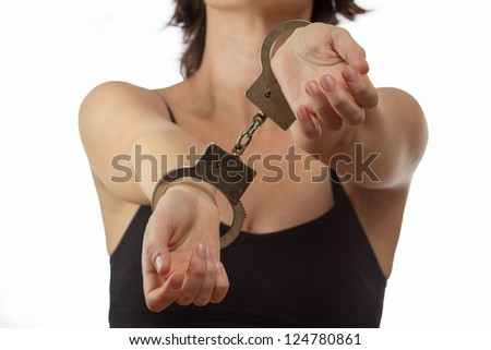 Young woman in handcuffs closeup - stock photo