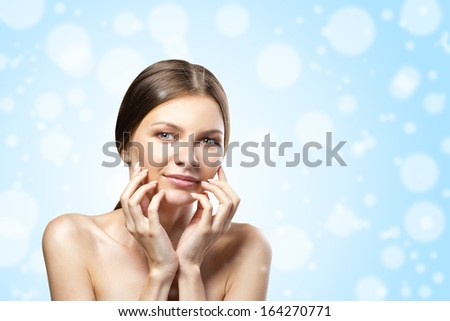 young woman in hat and gloves with  gift red box on snow background