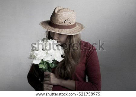 young woman in hat using.portrait of a cute girl. Dark style.