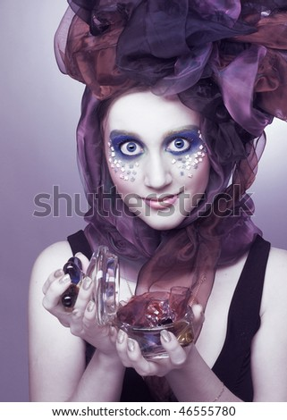 Young woman in hat with bows with vintage glass box in her hands - stock photo
