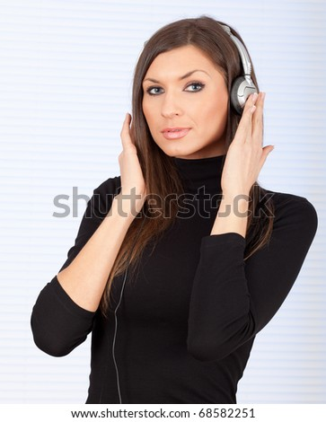 young woman in headphones listening music - stock photo