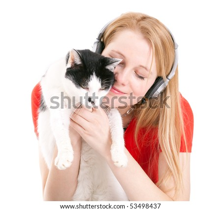 young woman in headphones relaxing with her lovely cat - stock photo