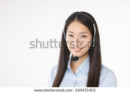 Young woman in headset - stock photo