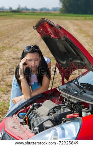 Young woman in her car breaks down. Engine failure - stock photo