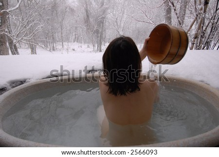 young woman in hot spring, Beijing - stock photo