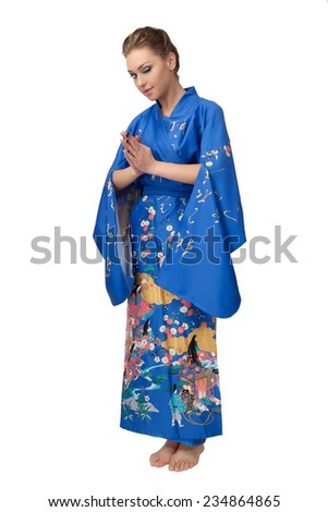 Young woman in Japanese kimono isolated on white background. - stock photo