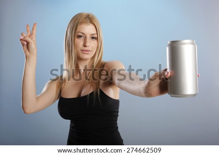 Young woman in jeans handles a drink - stock photo