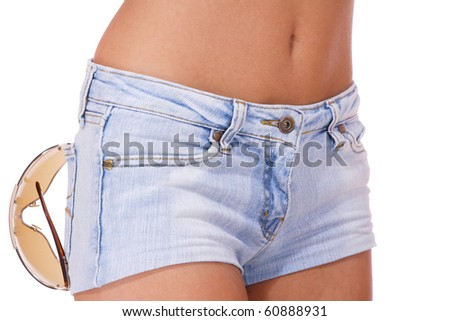 young woman in jeans shorts studio white