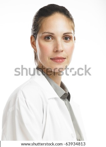 Young woman in lab coat - stock photo