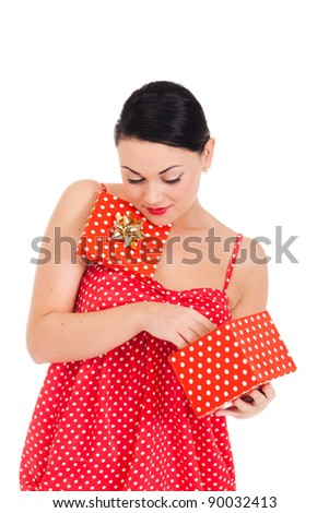 Young woman in ladybug-like dress and boxed present