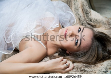 Young woman in lingerie lying on the floor