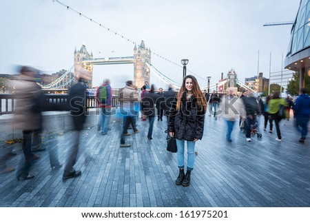 Young Woman in London at Rush Hour - stock photo