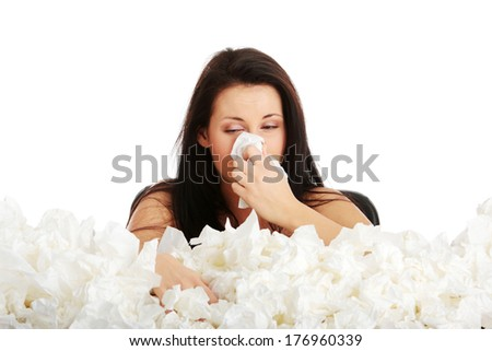 Young woman in lot of tissues around, ill, isoalted on white background - stock photo