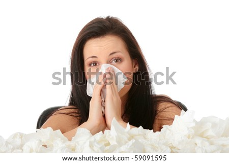 Young woman in lot of tissues around, ill, isolated on white background - stock photo