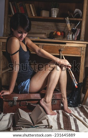 Young woman in love reading her diary.She sitting in her art studio.Fashion art image concept.