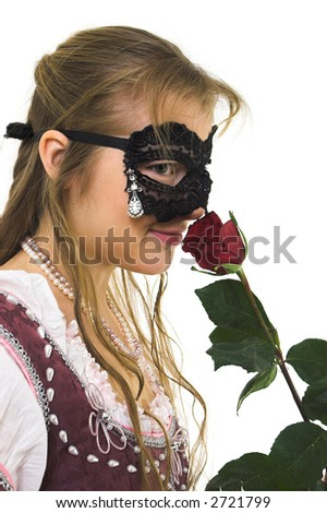 young woman in mask smelling red rose