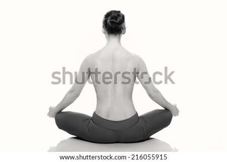 young woman in medi8tation on white background. Sitting back. Black and white - stock photo