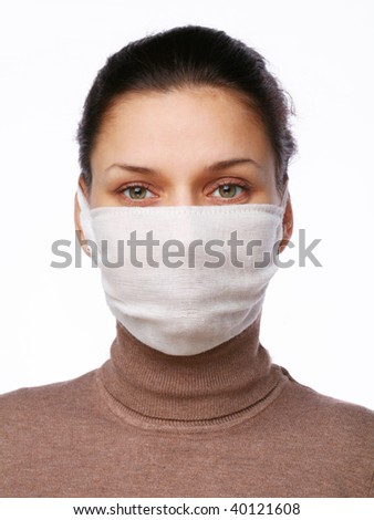 Young woman in medical mask on a white background