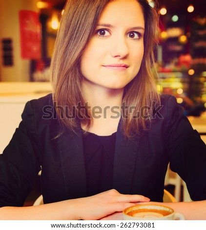 young woman in modern cafe - stock photo