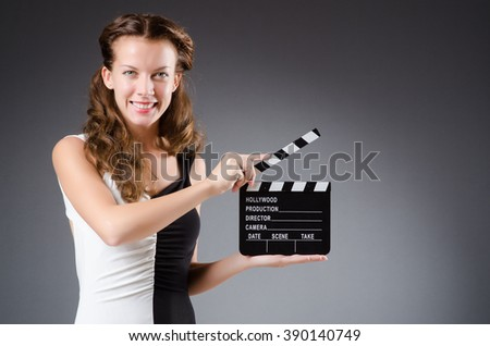 Young woman in movie concept - stock photo