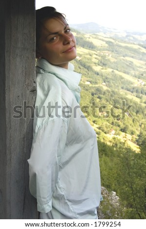 Young woman in nature surroundings - stock photo