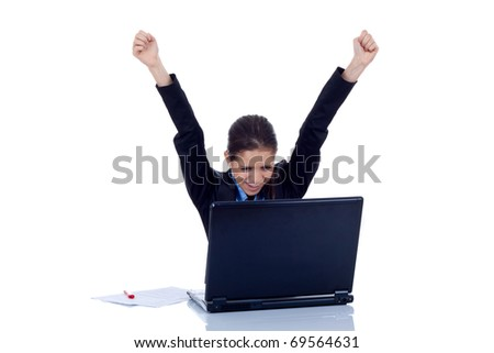 Young woman in office jubilates at desk. Isolated on white background. - stock photo