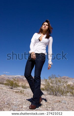 Young woman in open desert - stock photo