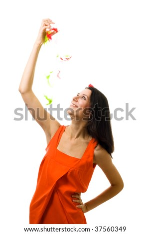 Young woman in orange dress with flying feather isolated on white - stock photo