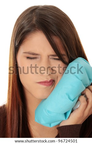 Young woman in pain is having toothache isolated on white - stock photo
