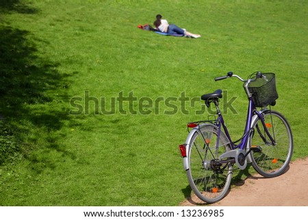 young woman in park with bike