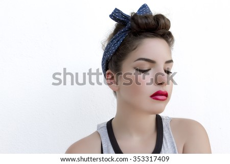 Young Woman in Pin-up style on white background  - stock photo