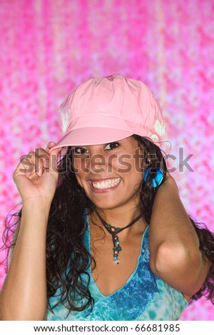 Young woman in pink cap