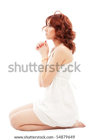 young woman in prayer pose - stock photo