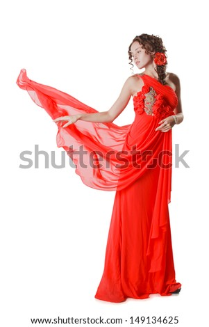 young woman in red dress isolated on white background - stock photo