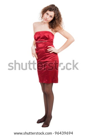 Young woman in red dress isolated on white background.