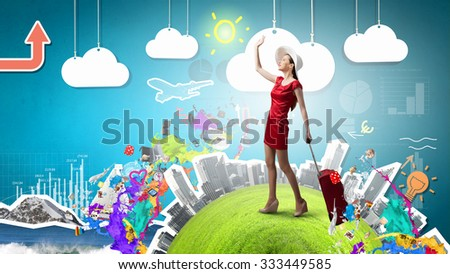 Young woman in red dress with red luggage gesturing with hand - stock photo
