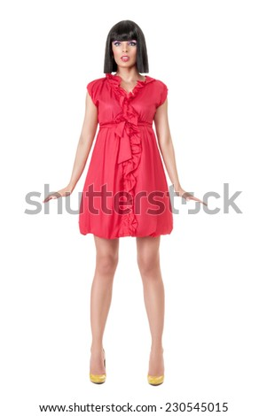 Young woman in red mini dress posing like doll isolated on white background - stock photo