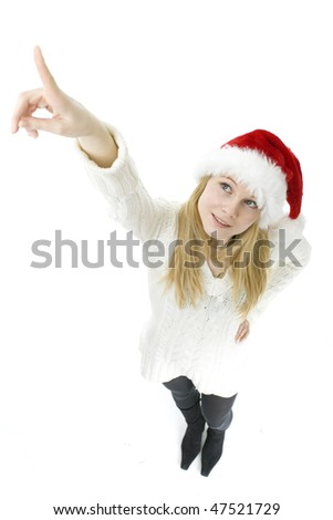young woman in red Santa cap pointing