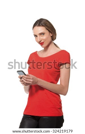 Young woman in red using smart phone - stock photo