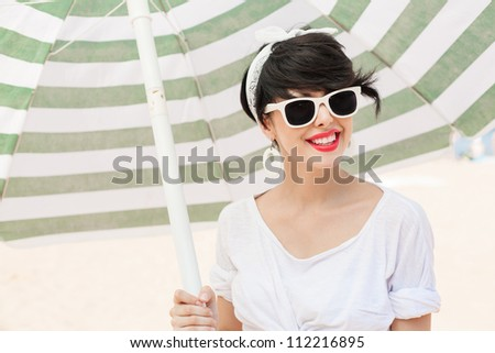 young woman in retro style by color parasol - outdoors - stock photo