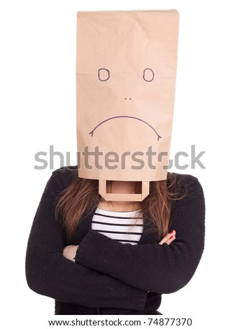 young woman in sad ecological paper bag on head with crossed arms, series - stock photo