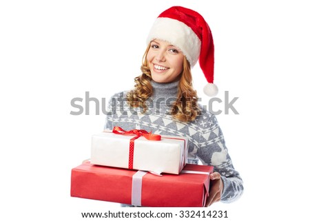 Young woman in Santa cap holding packages with Christmas gifts