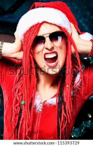 Young woman in Santa Claus costume is celebrating Christmas. - stock photo