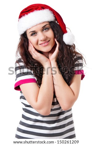 Young woman in santa hat, isolated on white background - stock photo